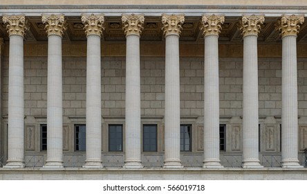 Neoclassical colonnade with corinthian columns as part of a public building resembling a Greek or Roman temple.
