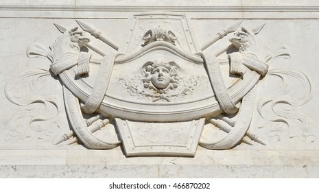 Neoclassical decoration with winged deity and two monsters face each other, from Vittoriano monument in Rome, designed by Sacconi in 1883