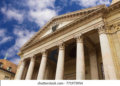 Neoclassical facade of St. Pierre Cathedral in cloudy weather in Geneva, Switzerland.