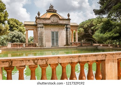 Neoclassical pavilion and a pond in the Horta Labyrinth Park in Barcelona, Spain