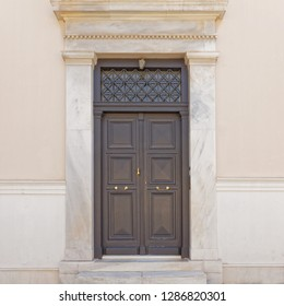 neoclassical style house entrance dark brown door, Athens Greece, Plaka neighborhood