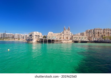 Neo-gothic Carmelite Parish Church and Balluta Buildings in Balluta Bay, St Julian's, Malta