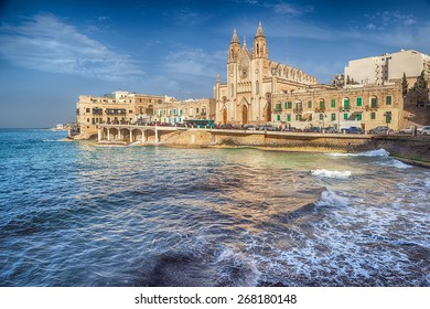 Neo-Gothic church of Our Lady of Mount Carmel (Balluta parish church) at evening under sunlight, situated in Balluta bay, Malta