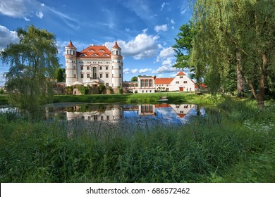 Neo-Gothic style palace surrounded by an English landscape garden in Wojanow, Poland