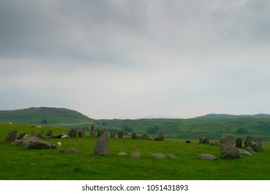 The neolithic Swinside stone circle near Broughton-in-Furness in Cumbria, England, UK as the summer solstice drew to and end