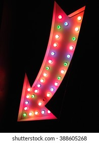neon arrow way point sign lights fairground carnival circus vintage style vegas bulb pointing at night red with light bulbs stock, photo, photograph, picture, image