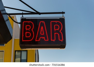Neon bar sign on the street