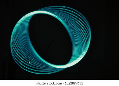 Neon blurry circles at motion . Swirl trail effect . Abstract luminous rings slow shutter speed effect . Light painting . Abstract lights at motion exposure time