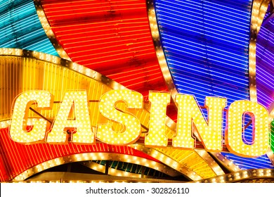 Neon casino sign lit up at night