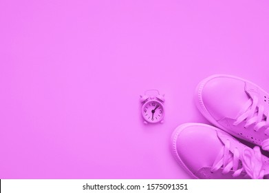 Neon color, light lilac sneakers and watches. Sport concept.flat lay style. Sport concept, Losing weight healthy lifestyle. Copy space.