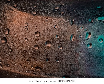 Neon condensation droplets on bottle