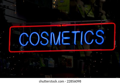 Neon cosmetics sign in the window of a Harlem, New York City store