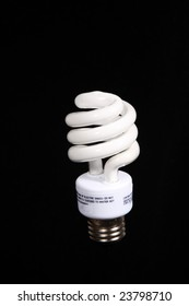 Neon energy saver light bulb with a black background.