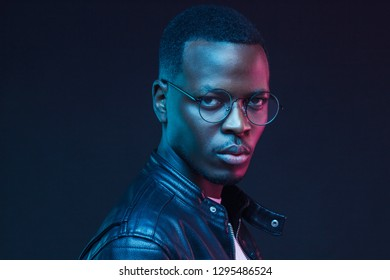 Neon futuristic portrait of african american young  male model wearing trendy eyeglasses