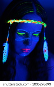 Neon hippie girl in blacklight on dark background