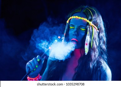 Neon hippie girl smoking hookah in blacklight