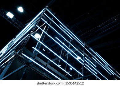 Neon lighting decoration on modern architecture detail of metal structure. Metal frame construction structure with Neon light