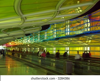 the neon lights in a corridor of a major international airport