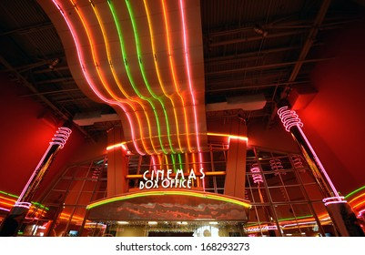 Neon lights at movie theater entrance and box office