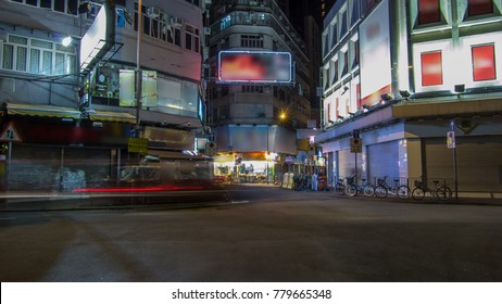 Neon lights on Tsim Sha Tsui street timelapse with traffic. Tsim Sha Tsui street is a very popular shopping place in Hong Kong. 4K