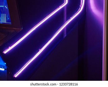 Neon lights purple violet UV over black abstract background