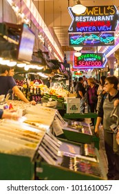Neon lights and stalls in Farmers Market, Pike Place Market, Belltown District, Seattle, Washington, USA North America 21 September 2017