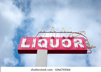 neon liquor sign with clouds