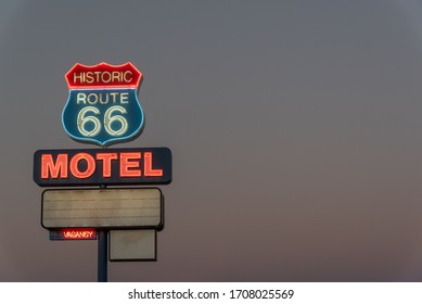Neon motel sign on Route 66 in the evening.