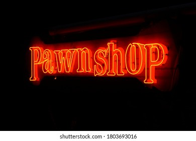 Neon pawnshop sign at night