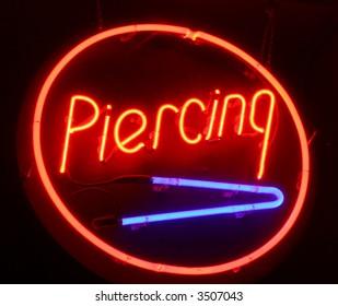 Neon piercing sign.