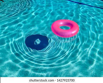 Neon Pink Float In Swimming Pool