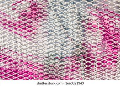 Neon pink red blue grate metal downtown Los Angeles painted wall macro