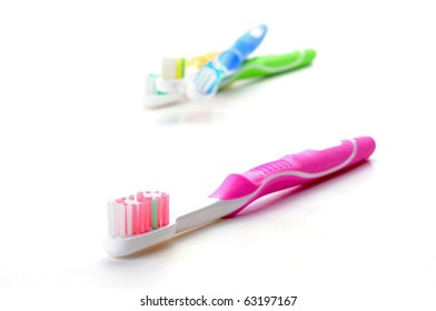 Neon pink toothbrush on a white background.