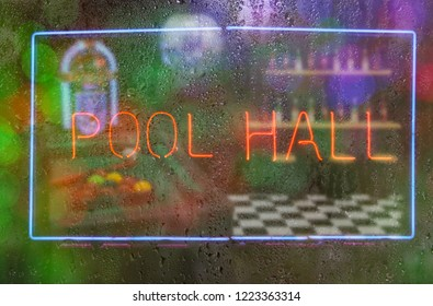 Neon Pool Hall Sign With Rainy Window