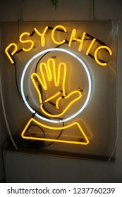 Neon Psychic Sign. Palm Reader Neon Sign.  Neon signs use different gases like Neon, Argon, Helium, to name a few.