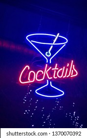 Neon red and blue cocktails sign