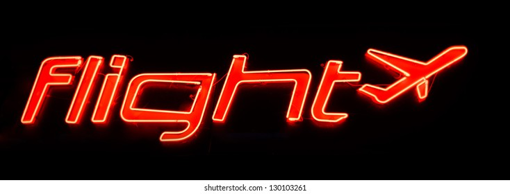 neon shining signboard with plane sign at night