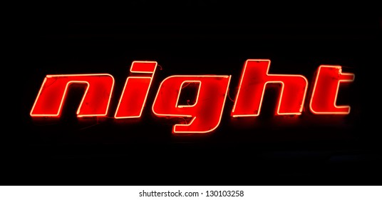 """neon shining signboard with red word """"night"""""""
