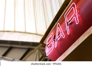 A neon sign above a bar