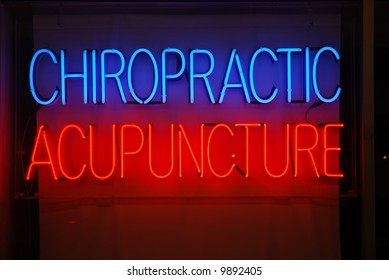 Neon sign advertising chiropractic and acupuncture services