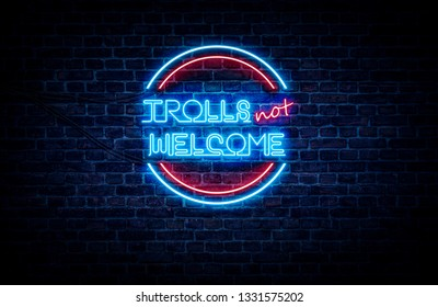 A neon sign in blue and red light on a brick wall background that reads: TROLLS NOT WELCOME