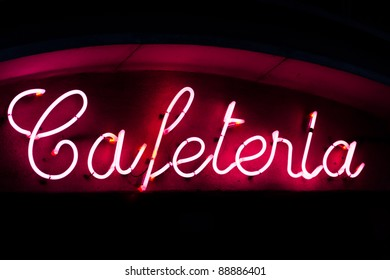 A neon sign of a cafeteria in the center of Madrid
