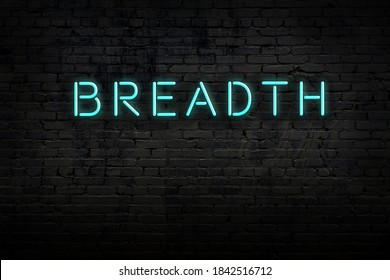 Neon sign on brick wall at night. Inscription breadth