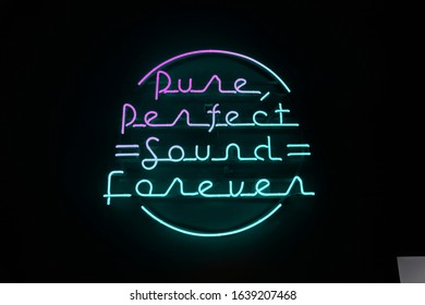 Neon sign on the wall with phrase about music