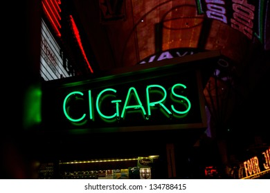 A neon sign promoting cigars