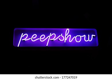 A neon sign reading 'peepshow' from the red light district in Amsterdam, The Netherlands.
