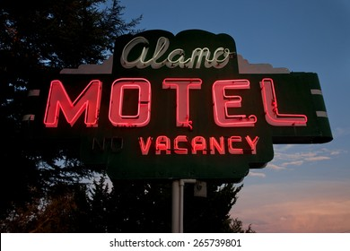"Neon sign saying ""Vacancy Alamo Motel"""" central california"