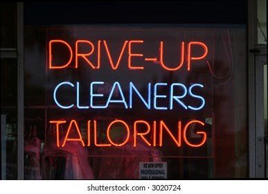 Neon Sign in a store window Drive-Up, Cleaners, Tailoring