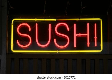 Neon Sign in a store window Sushi
