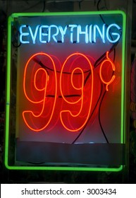 neon sign in window of 99 cent store